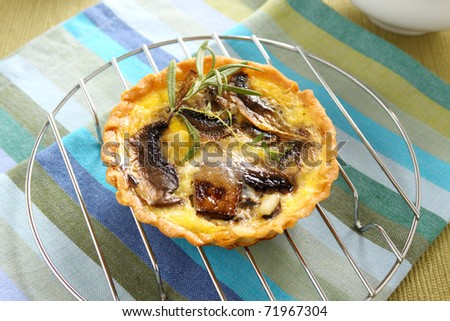 Mushroom quiche on a baking rack straight from the oven.