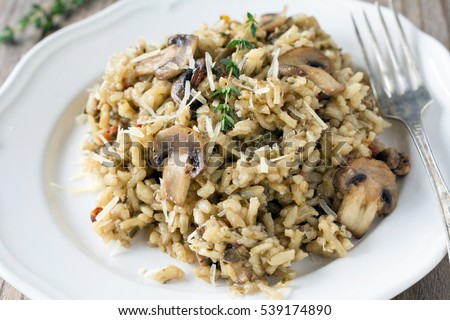 Shutterstock Mushroom risotto on white plate, close up view