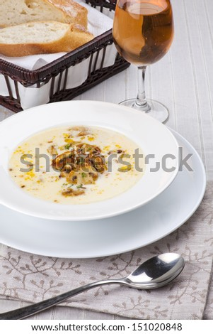 mushroom soup with bread and wine