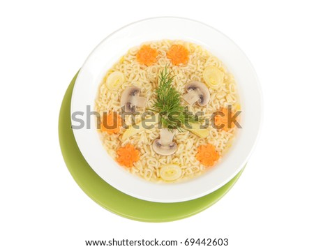 Mushroom soup with noodles in the form of the alphabet - stock photo