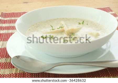mushroom soup with organic asparagus in a bowl
