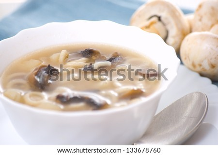 mushroom soup with potato and pasta - stock photo