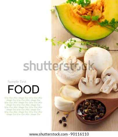Mushrooms and kabocha pumpkin with spices and herbs on cutting board
