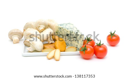 mushrooms, smoked cheese, blue cheese and ripe cherry tomatoes isolated on a white background