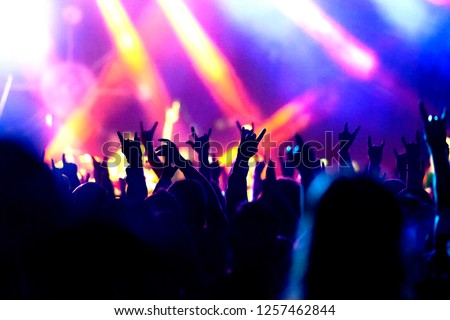 Music band crowds raising hands up in the air #1257462844