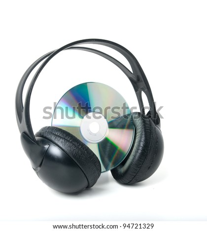 Music CD and headphones Isolated on a white background. Clipping path.