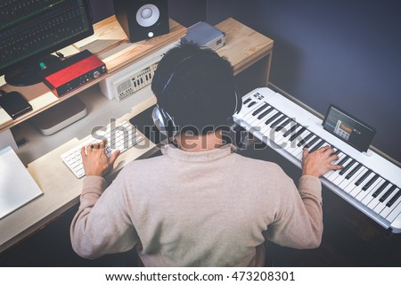music composer making songs in recording studio ストックフォト ©