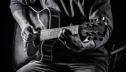 Music concept. Guitar acoustic. Play the guitar. Live music. Music festival. Instrument on stage, band. Electric guitar, guitarist, musician rock. Musical instrument. Guitars, strings Black and white