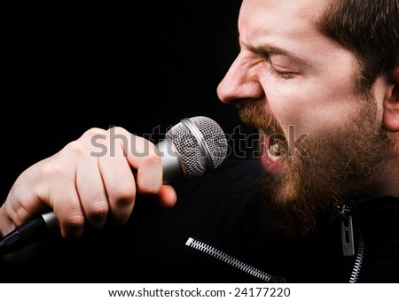 Music concept: portrait of rock male star screaming
