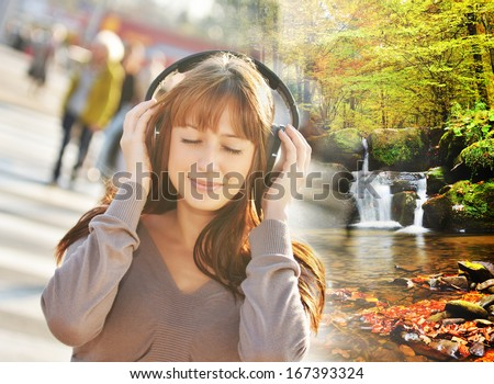 Music concept - Woman listening relating music in the city and teleport to the beautiful forest with waterfall