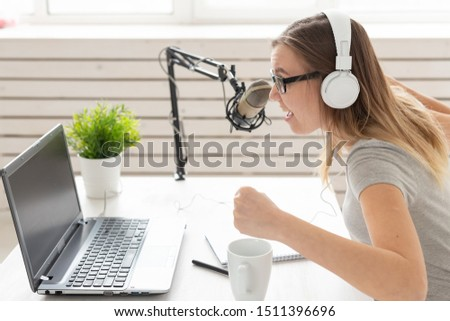 Music, dj, blogging and broadcasting concept - Female radio host with a funny expression