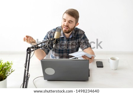Music, dj, blogging and broadcasting concept - Male radio host with a funny expression
