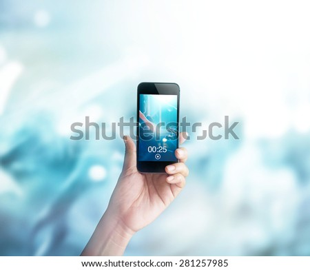 Music fans takes picture and video guitarist on stage in concert on smartphone, Pastel color tone and soft
