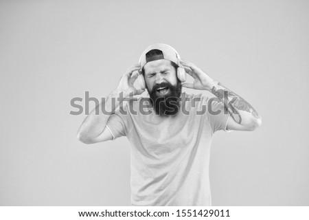 Music library. Feel rhythm. Bearded guy enjoy music. Equalizer player settings. Lifestyle music fan. Man listening music wireless headphones. Bass low sound. Hipster headphones gadget. Inspiring song. #1551429011