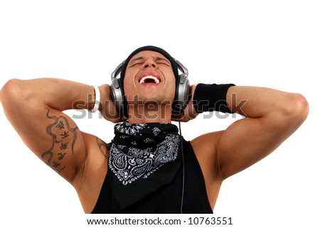 Music Lover A young man with headphones in black with lots of tattoos is screaming.