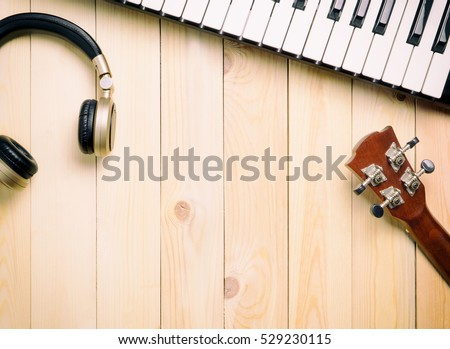 Music making instrument on wooden surface.