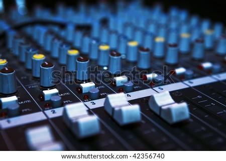 Music mixer desk in darkness. Dj mix club. - stock photo