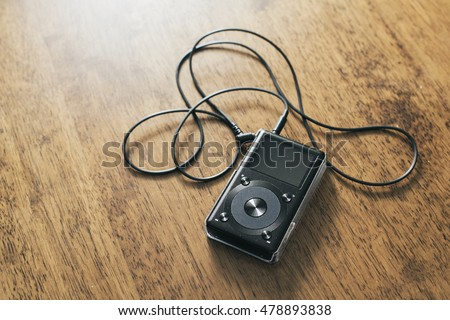 Music mp3 player on a wooden desk