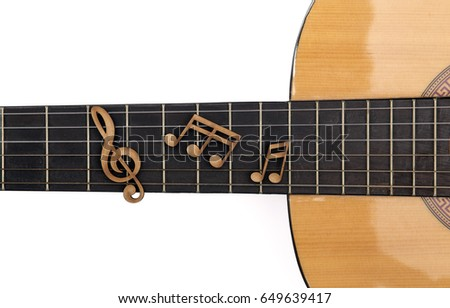 Music Note on Guitar