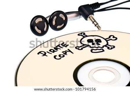 Music piracy with pirate copy cd and headphones - stock photo