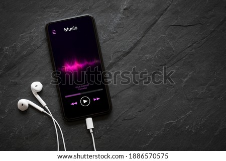 Music player on mobile phone with earphones