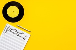 Music sheets with musical notes melody and vinyl record