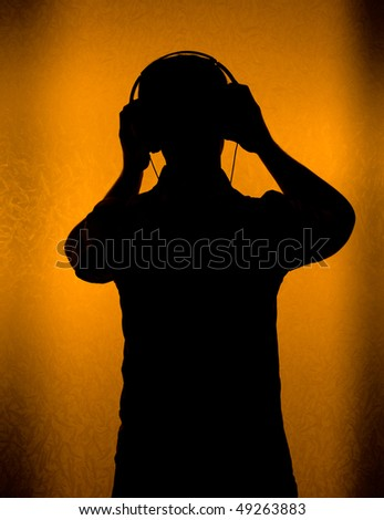 Music - silhouette of DJ with headset (back light)