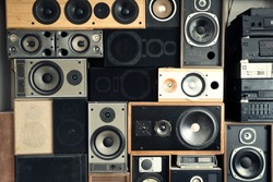 Music sound speakers hanging on the wall in retro vintage style, stacked sound boxes modern vintage