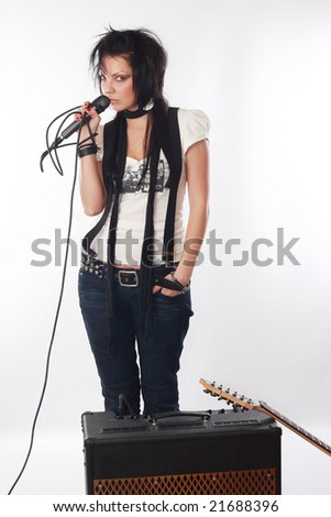 Music star.Sexy woman singing in mic