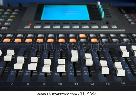 Music Studio Digital Sound Mixer controls.