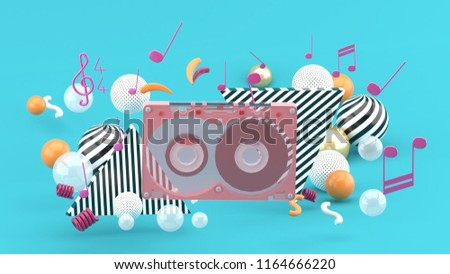 Music Tape among the colorful balls on the blue background.-3d rendering.