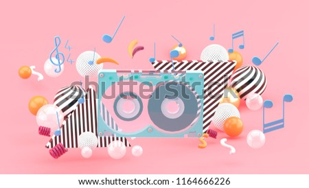 Music Tape among the colorful balls on the pink background.-3d rendering.