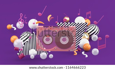 Music Tape among the colorful balls on the purple background.-3d rendering.