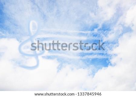Music violin clef sign or G-clef or treble clef in the sky. Abstract background. Music in heaven