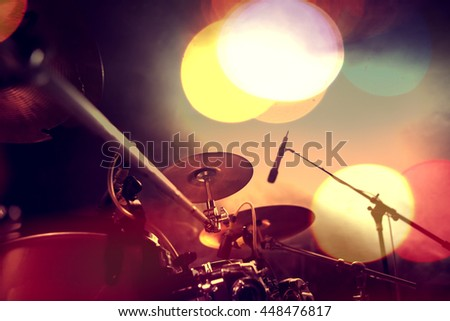 Musical background.Drum kit on stage lights performance.Live music.Concert and band on stage.Festival and show background