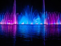 Musical fountain with colorful illuminations at night. Ukraine, Vinnitsa