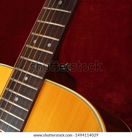 Musical instrument - Closeup fragment strings and neck vintage acoustic guitar.