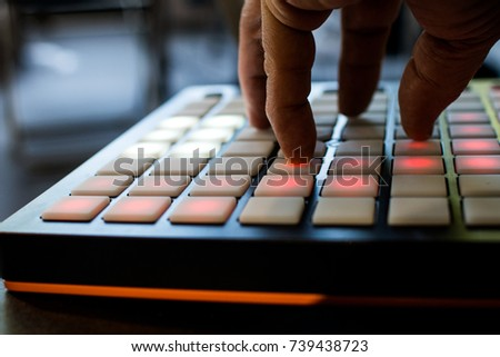 musical instrument for electronic music with a matrix of 64 keys in 8 x 8 files. Pad for music with buttons on angles illuminated by red - Shutterstock ID 739438723