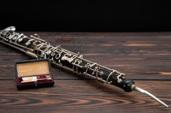 musical instrument, on the table lies an English horn with a reed
