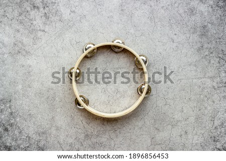 Musical instrument tambourine, top view. Music abstract background Stock photo ©