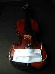 Musical instrument, violin with white cloth mask.