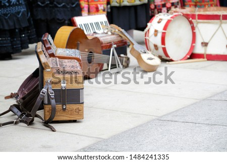 Musical instruments (accordions, guitars and drums) on the floor