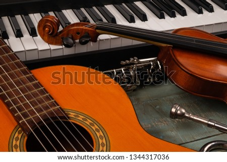 musical instruments in wooden background #1344317036