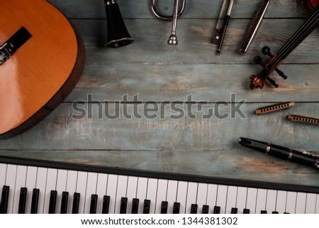 musical instruments in wooden background #1344381302