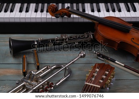 musical instruments in wooden background #1499076746