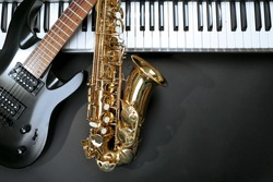 Musical instruments on black background