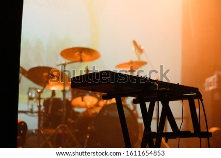 Musical instruments on the stage filled with orange light