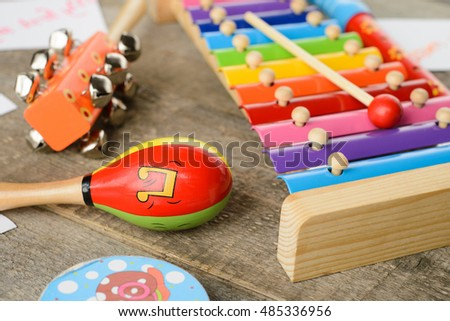 Musical instruments on wooden background #485336956