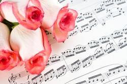 Musical sheet and flowers of roses