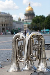 Musical wind instruments of the military orchestra on Admiralty Square. Rehearsal of the Navy Parade on July 25, 2021. St. Isaac s Cathedral in the background